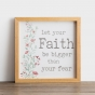 """This is a beautiful reminder to """"let your Faith be bigger than your fear."""" With soft water-color botanical details, this piece of art would be a great fit in any room."""