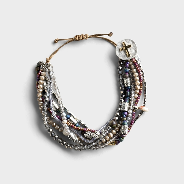 This handcrafted artisan bracelet encourages intentional living and quality time spent in prayer. Makes the perfect everyday piece, consisting of pearls, gemstones and glass beads.