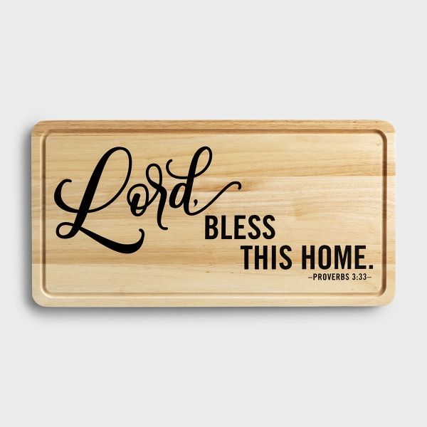 Our 'Lord, Bless This Home' decorative cutting board adds beautiful inspiration to your kitchen décor and can be easily displayed on a wall or easel. The Proverbs 3:33 Scripture message reminds us that the Lord blesses the righteous.