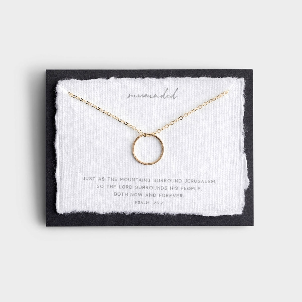 The delicate circle is meant to represent the love, protection, and guidance that surrounds us when we put our faith and hope in Christ. This inspirational gold necklace is set onto a handmade cotton paper verse card.